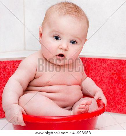 Cute baby having bath in a tub