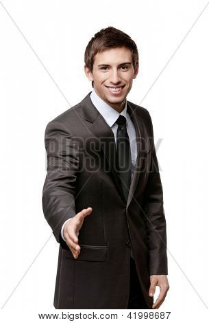 Friendly man giving hand for a handshake to seal the agreement, isolated on white