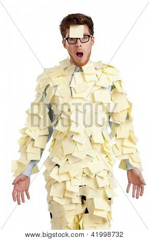 Young male with a sticky note on his face, covered with yellow sticky notes, isolated on white on white