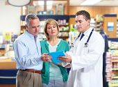 picture of medicare  - Pharmacist and a senior couple in pharmacy - JPG