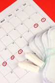 stock photo of tampon  - menstruation calendar with sanitary pads and tampons - JPG