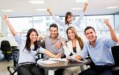stock photo of winner man  - Successful business team with arms up at the office - JPG