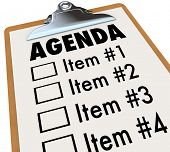 The word Agenda on a numbered list of things to do or cover, held on a clipboard, serving as a sched