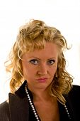 stock photo of pouty lips  - Woman with curly blonde hair and pearls and a sexy pouty look - JPG