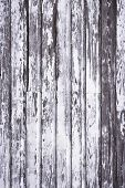 stock photo of 2x4  - Weathered and peeling white paint on barn - JPG