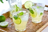 image of jug  - Lime juice with mint in jug and glasses