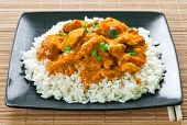 foto of chopsticks  - Chicken curry with rice and chopsticks on place mat - JPG