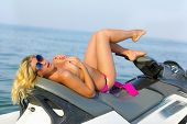 picture of jet-ski  - Beautiful sexy young blonde on a jet ski - JPG