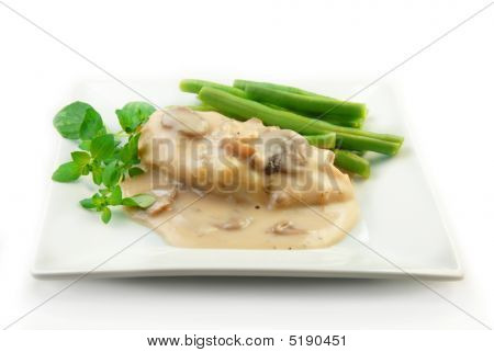 Chicken In Cream Sauce With Vegetables On White