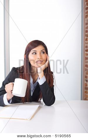 Business Woman Thinking In A Modern Office