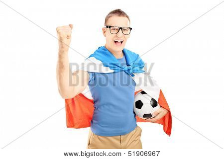Euphoric male fan holding a soccer ball and flag of Holland isolated on white background