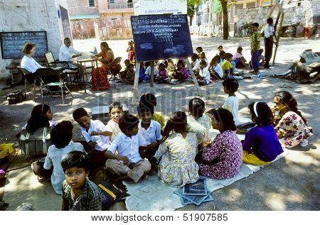 Teacher Teaches Children In The Outdoor Classroom