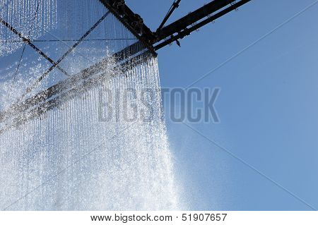 Sparkling Ornamental Curtain Of Falling Water