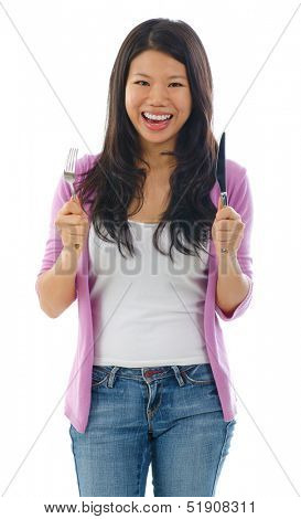 Asian woman holding fork and knife ready for food, isolated on white background