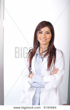 Female Doctor Arms Crossed In A Modern Office