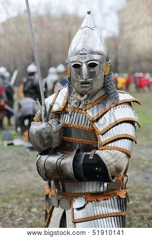 MOSCOW - APR 28: Warrior in armor with sword at Battle of East - Russia-Orda XI-XV centuries on Maneuvers East versus West, Apr 28, 2013, Moscow, Russia.  Organizer of event - Paladin fencing center.