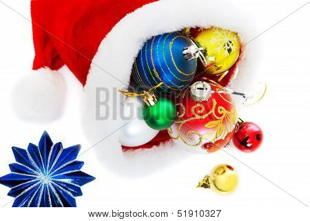 Santa's Cap With Ornaments Isolated On White Background