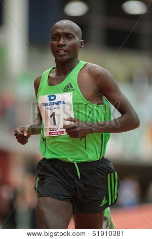 LINZ, AUSTRIA - JANUARY 31 James Kelwon (#1 Kenya) wins the men's 3000m event on January 31, 2013 in Linz, Austria.