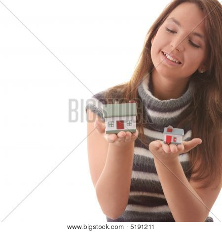 Young Woman With Two Hose Models In Hands