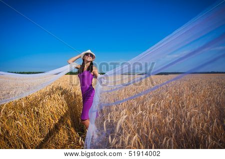 girl with veil on the yellow field