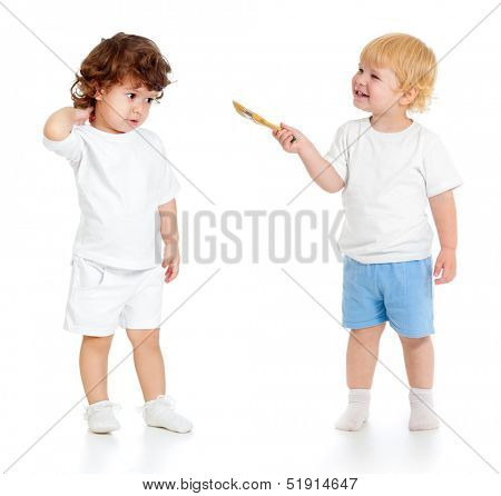 Baby boy with paint brush and girl standing full length isolated on white background