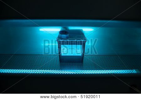 Box With Danger Virus Content Under Uv Ultravillet Light