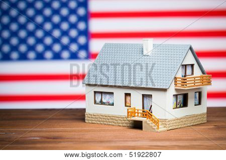 usa realty concept: house against american flag