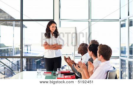 Confident Businesswoman Looking At Her Team In A Presentation
