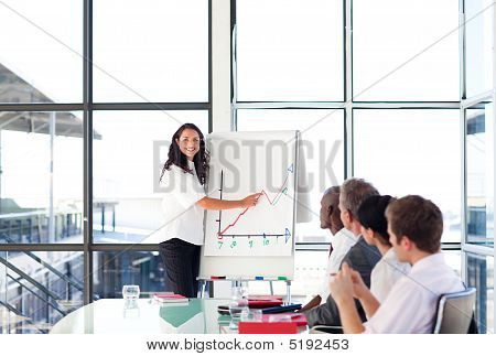 Confident Businesswoman In A Presentation Looking At The Camera