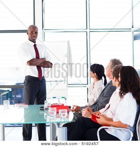 Young Confident Businessman Giving A Presentation