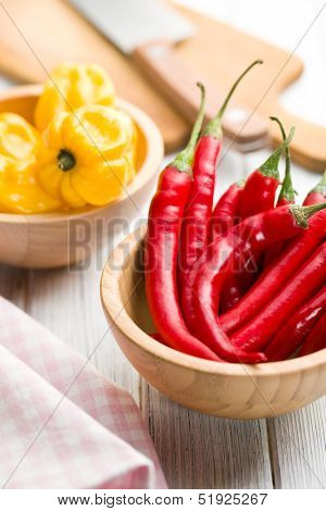 red peppers and habanero in wooden bowls