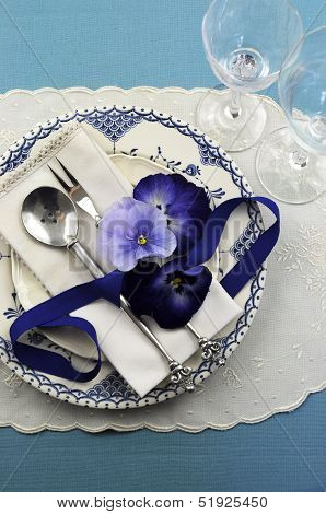 Vintage Blue Theme Table Place Setting With Blue Pattern Vintage Plate, Antique Silverware And Pansy