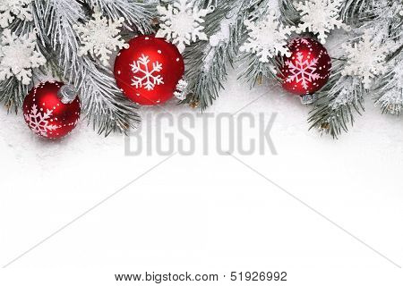 Christmas decoration with fir branch, Christmas ball and snow