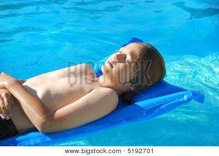 Sunbathing In Pool