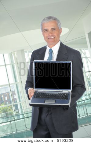 Middle Aged Businessman With Laptop Computer