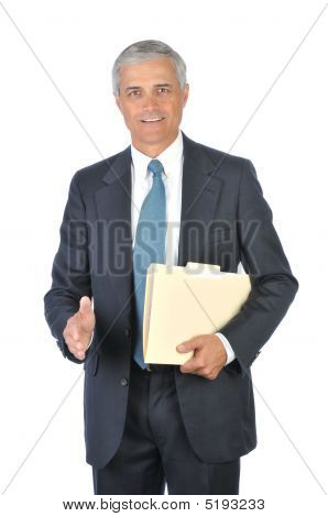 Middle Aged Businessman With File Folder Hand Extended To Shake