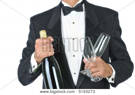 Man Wearing Tuxedo Holding Champagne Bottle And Glasses