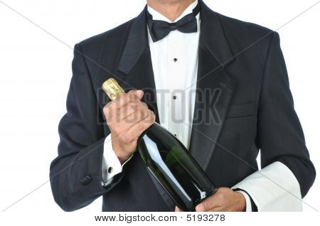 Sommelier Holding Bottle Of Champagne