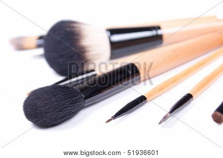 Close Up Of Professional Make-up Brushes Over White
