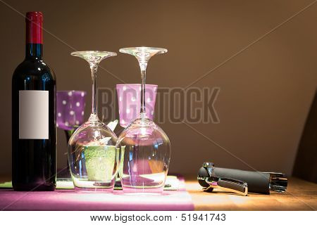 wine bottle with two glasses