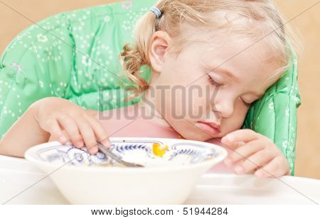 Little Girl Fell Asleep At The Table Eating Soup