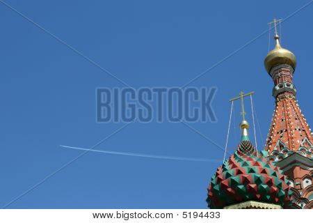 Airplane In A Sky And Saint Basil Cathedral At Red Square, Moscow, Russia