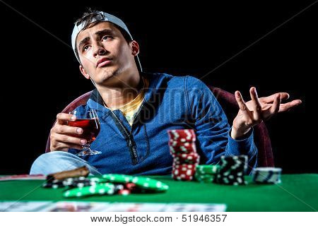 Young Gambler Holding Glass Of Cognac