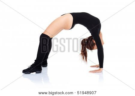 Athletic supple woman in a black leotard leaning over backwards arching her back with both her feet and hands on the floor  over white