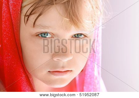 Closeup Bright Portrait Of Calm Blond Caucasian Little Girl In Red Shawl