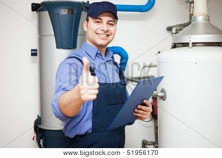 Smiling technician servicing a hot-water heater