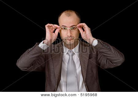 Aged Male Putting Up Glasses