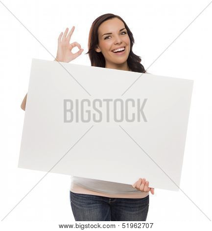 Beautiful Mixed Race Female Holding Blank Sign Isolated on a White Background Giving OK Gesture.