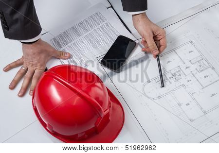 Above View Of Architect Hands Revising A House Project
