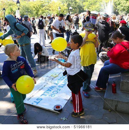 Kids work the balloon station